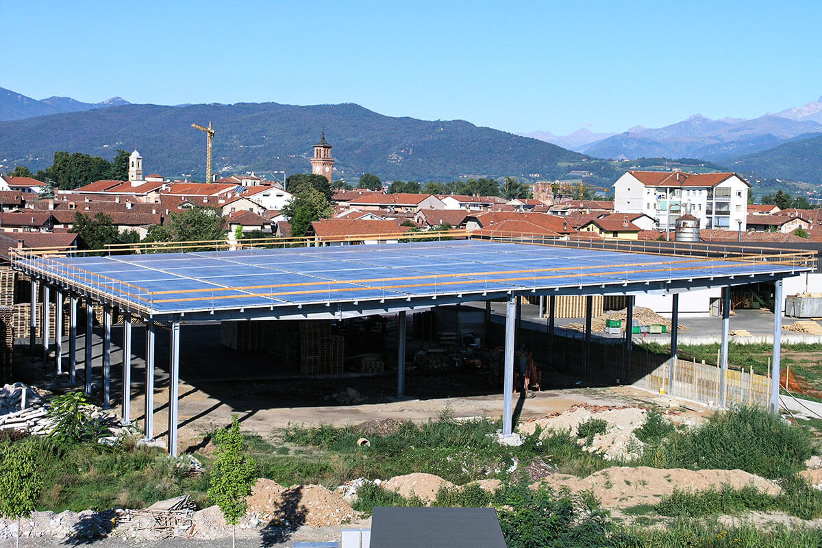 Photovoltaic systems on corrugated sheet roofs
